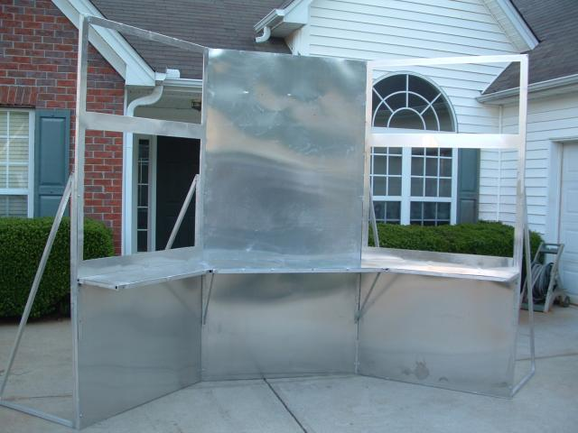 Custom fabricated aluminum trade show display for contractor with folding leaves