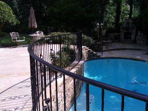 wrought iron handrails | Custom bending | with scrolls and twisted balusters | pool safety